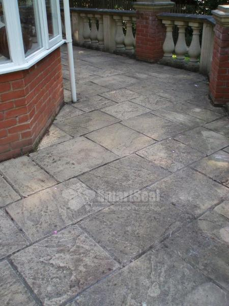 Paving slabs in need of cleaning and sealing